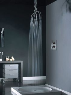 That would look awesome in the downstairs bath over the clawfoot. Almost looks like a chandalier!