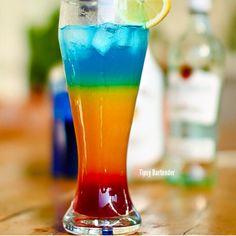 THE BARBADOS SURPRISE COCKTAIL 1/2 oz. (15ml) Grenadine 2 oz. (60ml) Orange Juice 2 oz. (60ml) Rum 1/2 oz. (15ml) Blue Curacao
