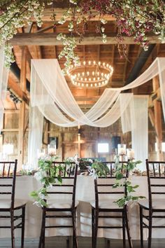 Sheer Drapery Panels If your reception space has tall, soaring ceilings, emphasize the height by draping gauzy panels overhead to create a romantic, ethereal feel.