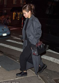 Showstopper: Selena chose baggy bottoms and a high neck top, no doubt keeping her warm in ...