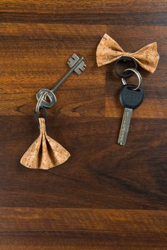 A beautiful and unique Key Chain handmade of cork. Cool gift for you and your loved one.  Size:  Bow Tie - 3 x 7 cm / 1.1 x 2.7 inches Skirt -  5 x 6 cm / 2 x 2.3 inches