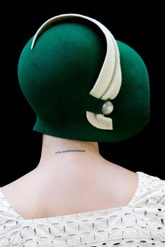 Classic forest green cloche hat is part draped and part blocked on an original 1920's block. The detail on the hat is eggshell white by 'yellowfield7' on Etsy.