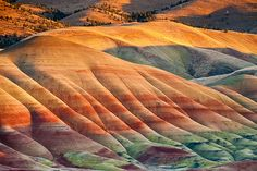 Painted Hills is one of the three units of the John Day Fossil Beds National Monument, located in Wheeler County, Oregon. It totals acres and is located 9 miles northwest of Mitchell, Oregon. Painted Hills is named after the… Continue Reading → Oh The Places You'll Go, Places To Travel, Beautiful World, Beautiful Places, Amazing Places, Beautiful Pictures, Formations Rocheuses, Painted Hills, Into The West