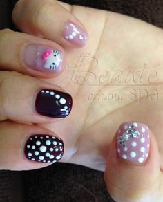 Close up Saijun's nails. Organic Dark Berry and Orchid Gel Manicure with Hello Kitty, Polka Dot and Crystal Bow designs.