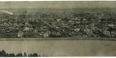 """Panoramic view from North Hill,    A handwritten note on the back of the postcard, dated 1912, reads: """"Calgary-taken from the North Hill about 12 months ago. City Hall there under construction. The clear portion of the photo shows what really was old Calgary. There are twice as many people living outside the radius of this picture as there are in it."""" The note was addressed to a Mrs F.B. Hartney at 8 Ford Street West in Toronto, Ontario."""