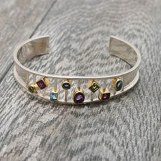 Kaleidoscope Cuff by MICHOU Peridot-Rhodolite Garnet-Blue Topaz-Iolite and African Amethyst Sterling Silver & 22k Gold accents - Size is 7 inches | Available from fusionartglass.com♥♥