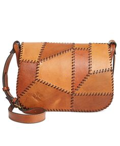 Destined to be a favorite, this Patricia Nash saddle bag is beautifully constructed from nine pieces of handcut vegetable-tanned leather, braided and hand sewn together with a single large needle. The