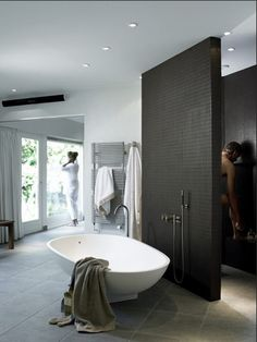 Love the open shower. I mean, the look is awesome but I'm modest as shit soooooo perhaps a certain or a wrap around