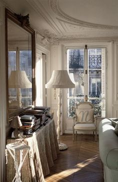 Antiques and classic traditional decor in a white room.