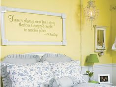 """Frame a wall quote: Cut pieces of wood trim to fit around the quote, attach the pieces with L brackets, and glue on medallions. Use picture-hanging hardware to mount the frame on the wall.  To see more of this room, turn to page 150 in our January 2014 issue: http://www.countrysampler.com/issues/detail.php?issue_code=C0114 Want to do this around """"All you need is love"""""""