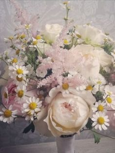 Striking Daisy and Roses wedding flower bouquet by Wildflower & Rose, wedding florists based in County Durham, UK. They are the leading suppliers of inspiring and beautiful wedding flowers for the North East of England. Wedding flowers - Daisy, Rose, pink, white, bouquet, UK