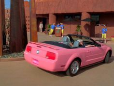 I want this carrr...pink mustang convertible! <3