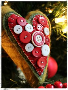 Felt ornament with cute button embellishments plus other ornaments.