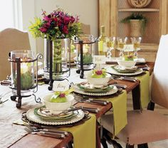 "TABLESCAPE:  ""This simple setting is a great example of ""layering"" tableware for a totally unique look. Instead of a tablecloth, individual runners highlight each place. Covington Accent Trays, used here as a chargers, are layered with Villa, Verde and Terrace Accent Plates, and a Villa Bowl (all retired). A lime, topped with a small fuchsia flower and ribbon, makes a great tag holder and provides a ""pop"" of color that accentuates the entire setting. """
