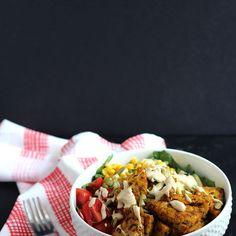 Vegan Curry Tempeh Salad Recipe Salads with tempeh, olive oil, coriander, tumeric, cumin, smoked paprika, salt and ground black pepper, fresh corn, pepitas, cherry tomatoes, leaf lettuce, tahini, water, garlic, lemon, smoked paprika, salt and ground black pepper