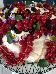 Pavlova with clotted cream and half a garden