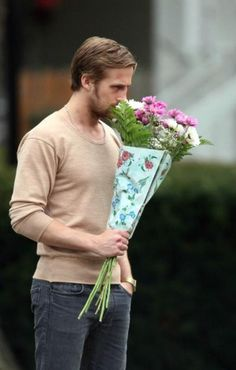 Ryan Gosling taking time to smell the roses.