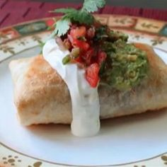 "Chicken and Mushroom Chimichangas | ""Packed with chicken, mushrooms, and poblano peppers, these chicken and mushroom chimichangas are sure to please!"""