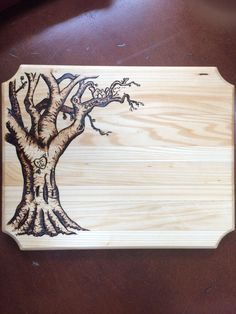 I'm not sure if wood burning really counts as woodworking but this is a cutting board I made for an anniversary when I was too cheap to buy the real thing off etsy : woodworking