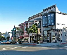 Wonderful pic of my favorite little town -Pacific Grove. I've been on that block so many times, and never tire of it.   Victorian storefronts on Lighthouse Avenue in Pacific Grove