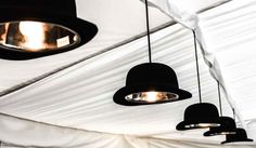 Bespoke Bowler hat pendant lights created for a James Bond themed birthday party by Apollo Event Consultants