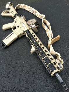 "LaRue Tactical – Costa Edition OBR FDE 14.5"" pinned surefire break  with PredateAR handguard, VTAC sling, and EOTECH."