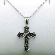 Many cultures including the ancient Greeks believed that Marcasite would attract wealth and inspire creativity. This lovely Marcasite cross is complete with an