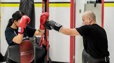 Muay Thai & Martial Arts - Mike Miles is the original Muay Thai gym in Calgary, cardio kickboxing classes & best Mma Gym in Calgary. We have over 35 classes. Kickboxing Classes, Cardio Kickboxing, Gym Classes, Muay Thai Workouts, Muay Thai Gym, Muay Thai Martial Arts, Mma Gym, Kids Gym, Gym Trainer