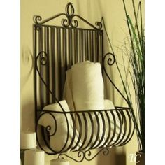 Decorative Wire or Metal Wall Baskets for storage of towels, hair dryer and irons and lots of other uses