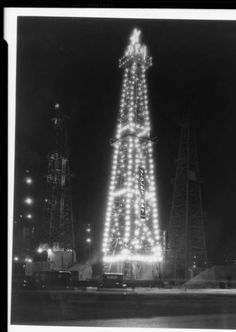 """Christmas oil well, General Petroleum Co., Southern California, 1930 [image] :: Christmas oil well, General Petroleum Co., Southern California, 1930 :: """"Dick"""" Whittington Photography Collection, 1924-1987. http://digitallibrary.usc.edu/cdm/ref/collection/p15799coll170/id/948"""