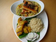 Angelica Kitchen ~   Colorful navratan korma featuring dragon tongue beans, beefsteak tomato, green beans, Yukon gold potatoes, sweet peas & carrots, grilled red, yellow & green peppers, raisins & ground cashews, simmered in coconut-ginger stew with masala spices & cayenne; served with zesty basil roasted tofu & fragrant brown jasmine rice. Accompanied by roasted delicata squash & pickled black Spanish radishes; garnished with dandelion greens.