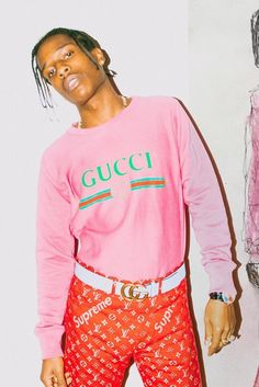 ASAP Rocky wearing  Gucci Vintage Logo Sweatshirt, Gucci Leather belt with Double G buckle, Louis Vuitton Supreme Monogram Pants