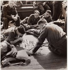 [Soldiers playing chess on deck of a troop ship from England to Casablanca]