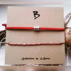 set of 2 red suede cord and string bracelets with a charm target by BodhichittaBySB on Etsy