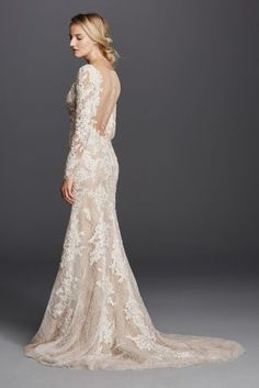 Sultry brides look no further! This dramatic lace sheath is one your guests will never forget! Allover lace paired with nude fabric gives the illusion of a nude gown. Long lace sleeves provides glamarous coverage of shoulders and arms. Deep v-neckline accentuates the bustline, while low back adds sultry detail. Sweep train. Sizes 0-16. Available in Ivory/Nude in select stores. Fully lined. Back buttons. Dry clean only. Extra Length: Style 4XLSWG719.