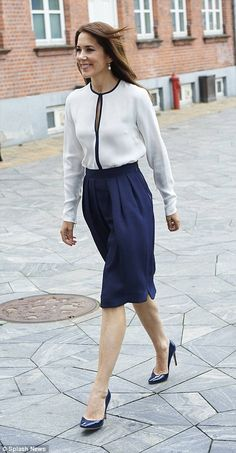 Chic: The Australian-born princess matched the top with a navy skirt and heels...