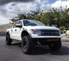 White Lifted Ford Raptor F-150 SVT Truck