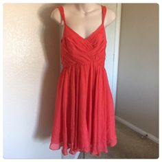 """♣️ Anthropologie Rebecca Taylor Silk coral dress This is a gorgeous Anthropologie Rebecca Taylor dress. 100% silk and fully lined. Coral sleeveless top. Zips on the side for a fitted top. Bust 31"""" waist 26"""" length 38"""". Size 2.  TradesModeling ✅Smoke free home✅  ✅Offers considered✅ Please use the blue 'offer' button to submit an offer.   Bundle 2 or more items for an automatic 15% discount. Anthropologie Dresses Midi"""