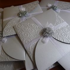 Another pinner wrote:Handmade Invite-Embossed Silver Wedding Theme    Could be changed up for bridal shower :)