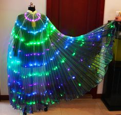 Buy our Belly Dancer Outfits with LED Fan Veils in different color combinations & variations like red, blue, purple, pink, white etc.