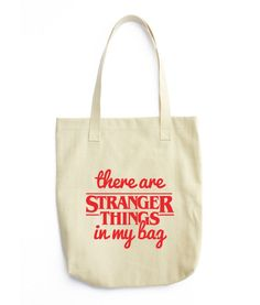 There are Stranger Things in my bag! Perfect gift for Stranger Things fan. Bull Denim Woven Cotton construction Dimensions: 14 x 14 x Dual handles Fabric weight oz/yd² g/m²) All-purpose natural cotton tote bag. Stranger Things Gifts, Eleven Stranger Things, Should I Stay, Bracelet Quotes, Romantic Cards, Goodie Bags, Dad Hats, Classy And Fabulous, Cool Shirts