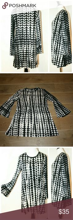 Cherish Tie Dye Tunic / Dress sz Med - silky knit Cherish Tie Dye Tunic / Dress.  Size Medium.  Silky smooth knit drapes beautifully.  Long-sleeve with bell sleeves.  Pair with sandals and wear as a mini dress. Be Pair with leggings and boots and wear as a tunic.  Black & white tie tye fabric.   EUC. No stains, rips, holes, tears, marks, snags or defects. Cherish Dresses Mini