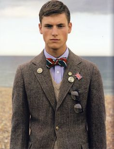 "Wearing a bow tie is a statement. Back in the day it said ""Preppy"". Nowadays it says ""Hipster"" or occasionally ""Liberal"". His says: ""Why am I at the beach in a three piece suit?"""