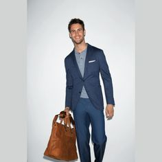 Boglioli ss12 - blue sport coat, light grey polo, white pocket sqaure, blue pant, tan leather bag