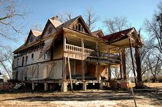 This is now. Harville House Abandoned Rural Southern Farmhouse Folk Victorian Architecture Dilapidated Pressed Tin Roof Pictures Image Photo Copyright Brian Brown Photographer Vanishing South Georgia USA 2011