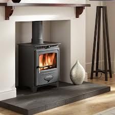 The Hamlet Solution 5 Wood Burning Stove has a pre-stressed curved body for greater strength and features an airwash system for a cleaner glass viewing window. This indoor stove heater is a wood burner with a primary air diversion system and secondar . Corner Wood Stove, Wood Gas Stove, Wood Stoves, Pellet Stove, Log Burner Fireplace, Wood Burner, Inset Stoves, Log Burning Stoves, Dining Room Storage
