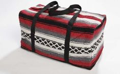 Our Falsa Blanket Duffel Bags are handwoven in the same designs as our traditional Falsa Blankets. In red. #southwest #southwestern #western #bag #weekenderbag #duffelbag #falsablanket #southweststyle #southwestdesign #elpasosaddleblanket #elpasosaddleblanketcompany