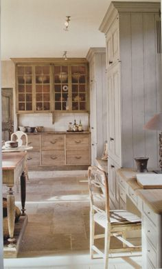 Antique dresser nestled into the kitchen remodel.  I love this look and those wide, deep drawers are great for a kitchen!
