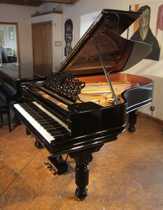 An 1886, Steinway Model B grand piano with a black case, filigree music desk and fluted, barrel legs. Piano has an eighty-five note keybpard and a two-pedal lyre at Besbrode Pianos £28,000