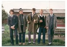 """This photo is very representative of the """"mod"""" style of the early 60s described on page 52.(Hebdige) Obsession with crisp collars, custom made jackets, and a generally subdued style are all evident in these boys."""